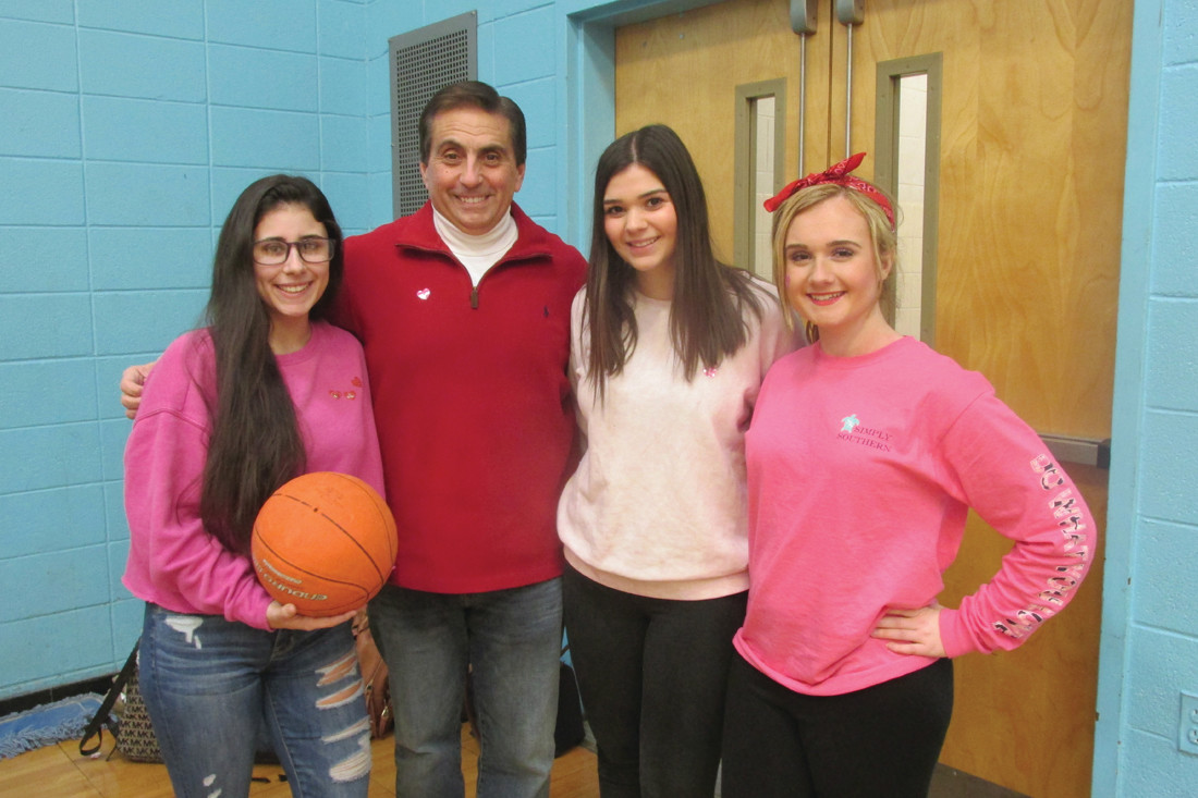 SADD officers Taylor Medeiros, Alyssa Johnston and Fallon Davis join Faculty Advisor Greg Russo prior to the basketball potion of the recent Hoops for Heart.(Sun Rise photos by Pete Fontaine)