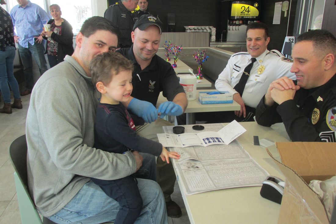 SAFETY FIRST: Richard J. DelFino IV, son of Johnston Town Councilman Richard J. DelFino III, was among the first of 100 children to be fingerprinted during the unique Safety Saturday hosted by McDonald's at the newly-renovated location on Atwood Avenue. (Sun Rise photos by Pete Fontaine)
