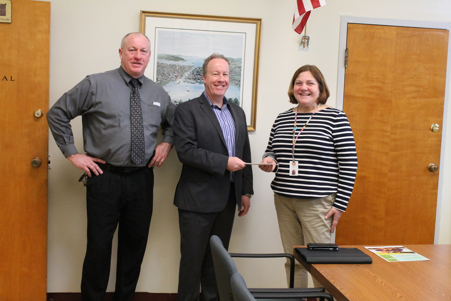 CHECK RECEIVED: Gerry Habershaw, principal of Pilgrim High School, along with Dori Labella, head of the science department, receiving the grant money from Paul Hickey from Toshiba.