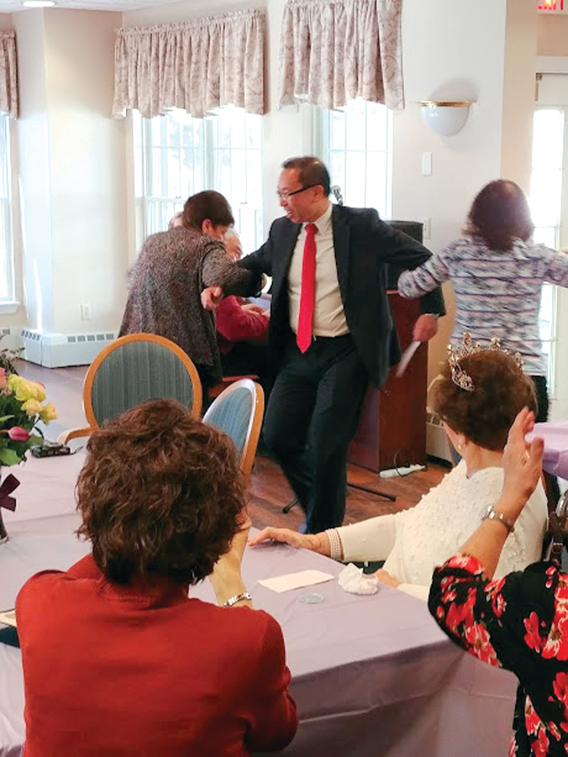CELEBRATING OLGA SUSI: Mayor Allan Fung takes part in the dancing, singing and celebrating at Susi's birthday party.