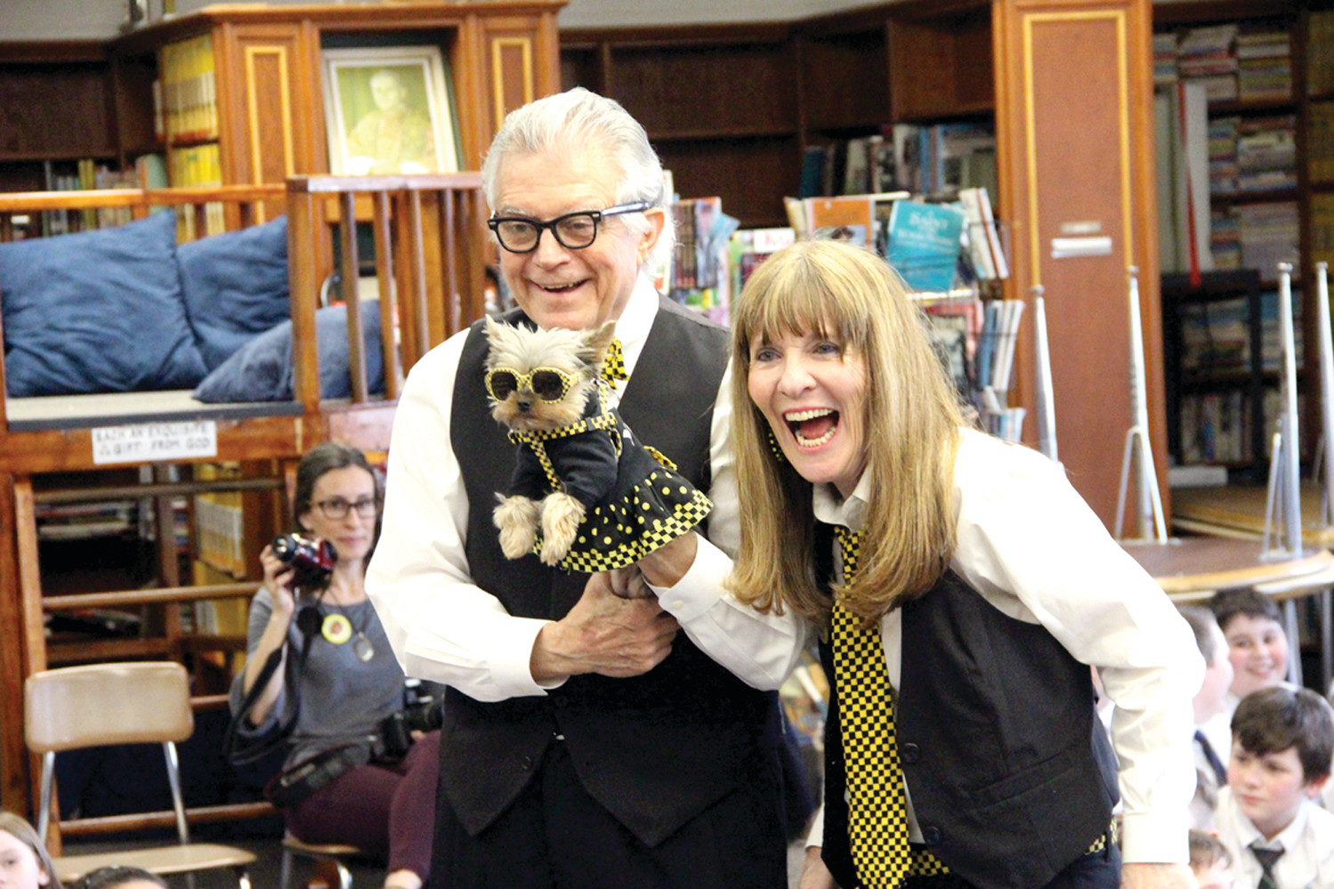 MAKING A HIT: NYC meteorologist Ron Trotta, Elly McGuire and furry celebrity pup Schmitty put on a show for St. Kevin students.