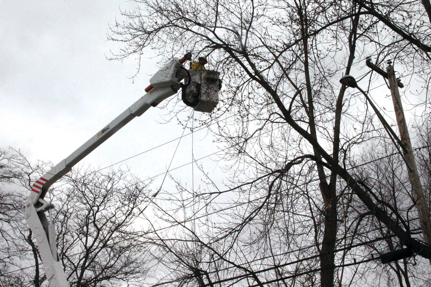 WIRING IN THE WIND: A crew worked on West Shore Road Saturday morning to restore power to Conimicut.