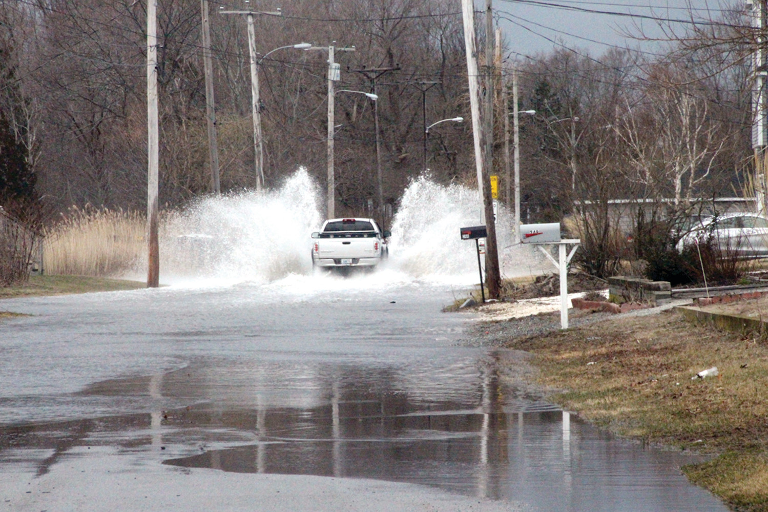 RIDING THE TIDE: The driver of a truck wasn't deterred by a flooded Shawomet Avenue during Saturday's high tide. Most motorists found a detour.
