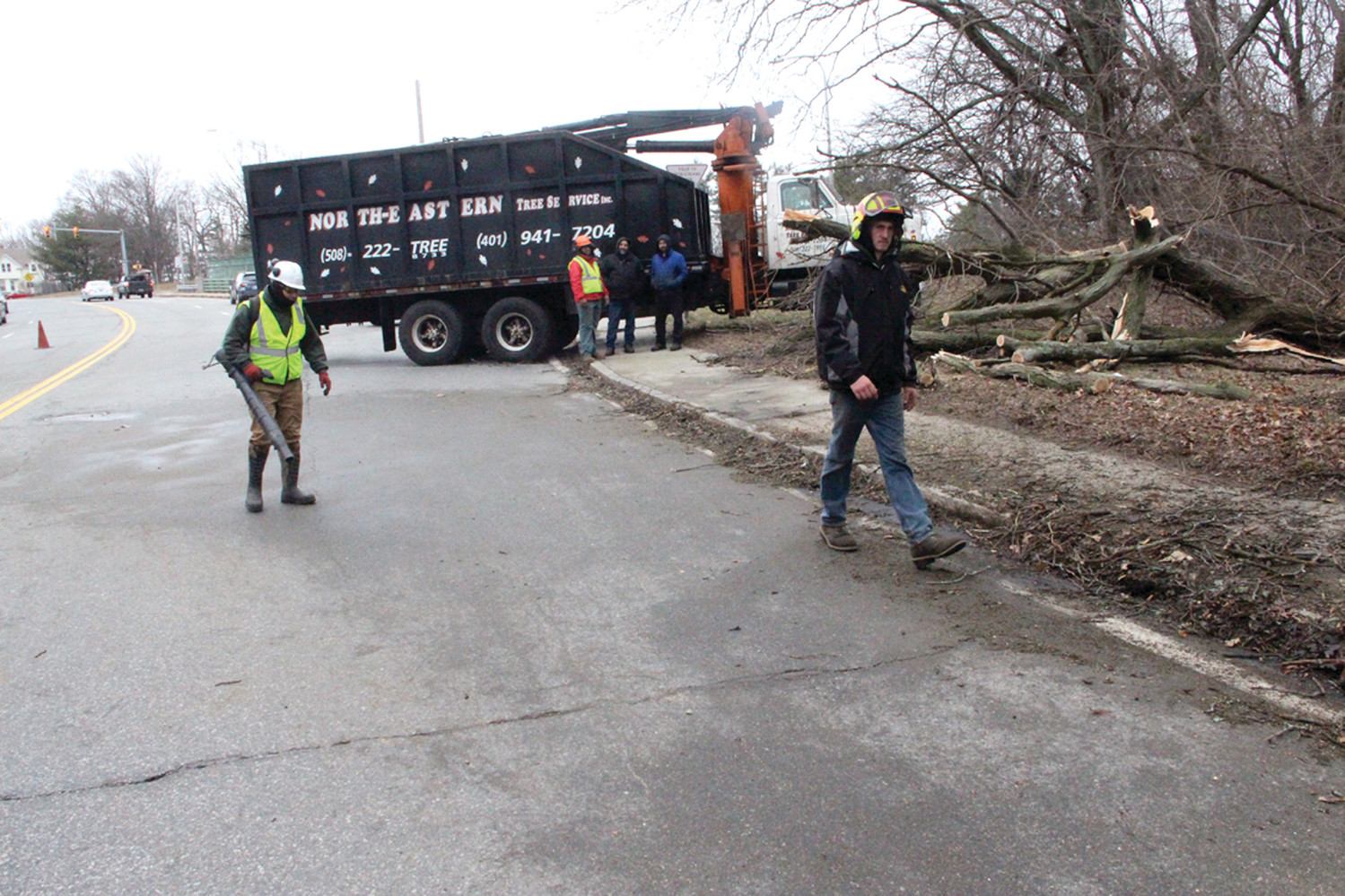 FAST WORK: A Northeaster Tree Service crew had two-way traffic restored to Park Avenue by Saturday morning. after clearing a downed tree  at the on ramp to the Route 10 connector.