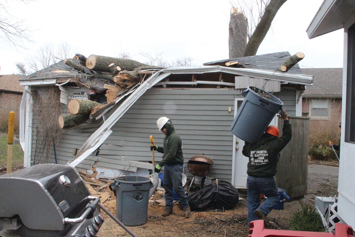 The crushed garage at 2073 Broad Street. Crews from Northeastern Tree Service had most of the tree cleared by Saturday morning.
