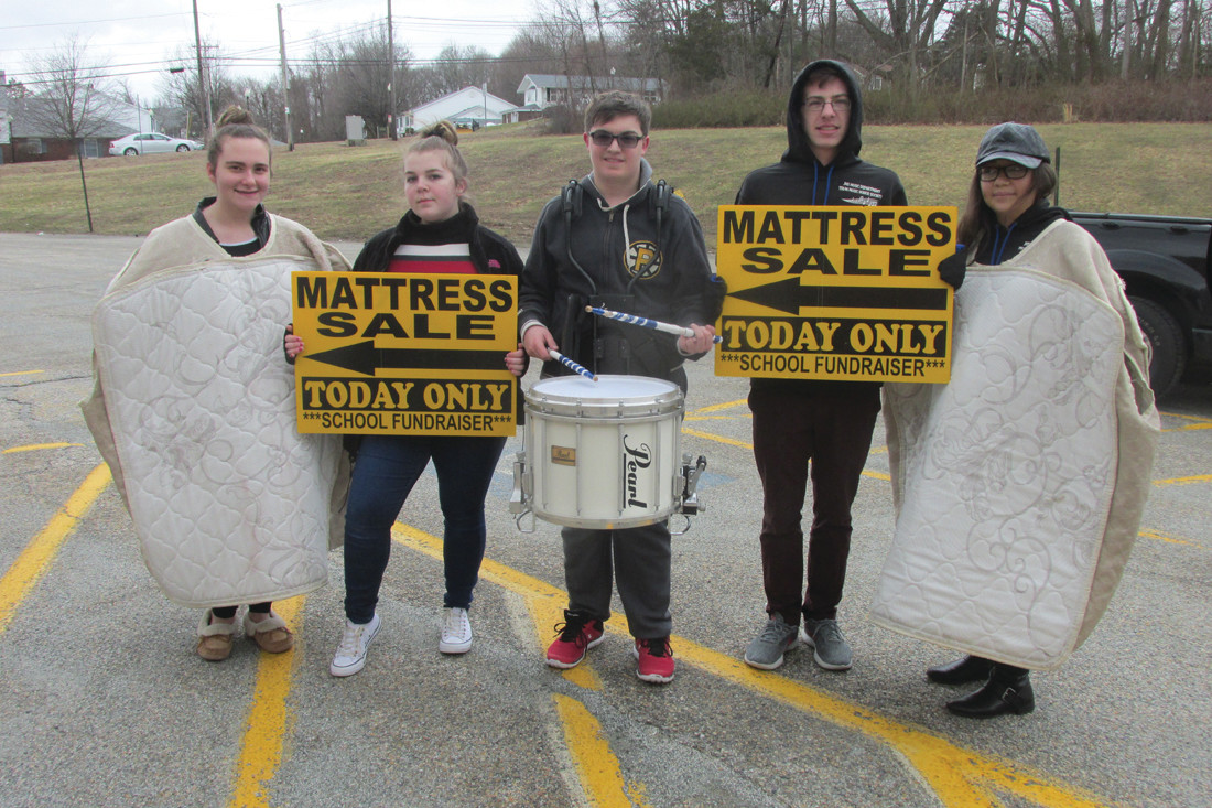 SUPER SELLERS: Among those Johnston High School music students who helped make Saturday's 2nd Annual Mattress Fundraiser and overwhelming success were, from left: Ashley DiLorenzo, Abigail Bartlett, Anthony Andrade, Elizabeth Cruz and Joe Johnston. (Sun Rise photos by Pete Fontaine)
