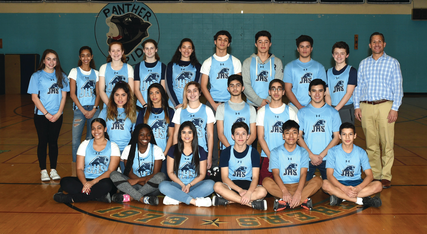 DIMAIO'S DYNAMOS: The first ever JHS coed indoor track and field team includes, sitting in front: Ariel Then, Lala Olagundoye, Linda Carrascoza, Guillermo Hurtado and Jose Echeverria. Middle: Jade Verajano, Jadelin Reyes, Audry Mahony, Kevin Saker, Shaheer Jamil and Carlos Fragoso. Standing: Grace Centracchio, Irissa Jimenez, Melanie Vessella, Brynn Roche, Vanessa Pichardo, Sean Young, Frank Heredia, Andre Pineda, Nick Petrillo and Coach Lou DiMaio. (Submitted photo)