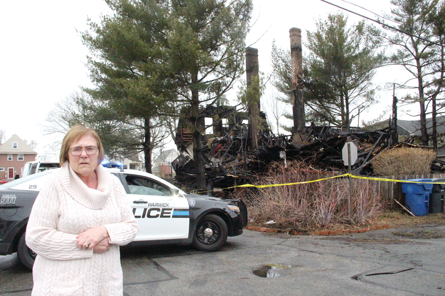 A NEIGHBOR'S HOME: Karen Oliver Legg (pictured) and her husband, Jim, welcomed Diana Turgeon and Michael Spooner into their home early Wednesday morning. A fast moving fire reduced the Turgeon/Spooner home at 19 Royal Avenue to rubble late Tuesday night.