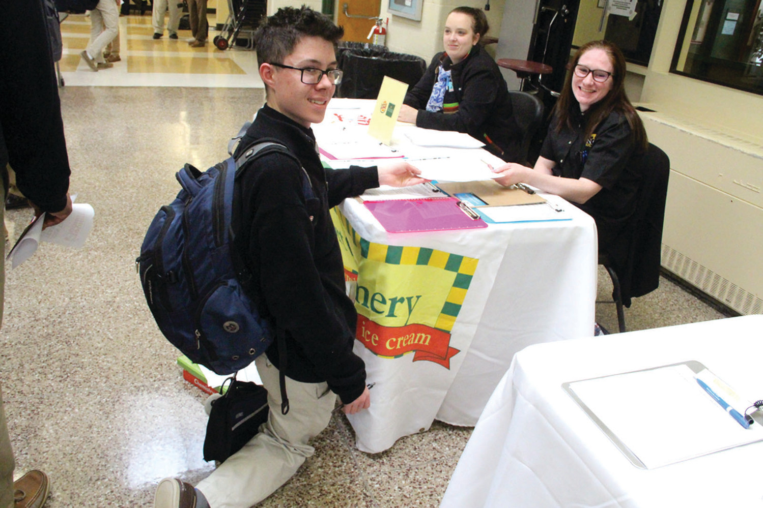 A PRAYER COULD HELP: Hendricken student Joseph D'Alfonso was on his knees Tuesday as he filled out a job application with Elizabeth Brennan of the Warwick Avenue Newport Creamery.
