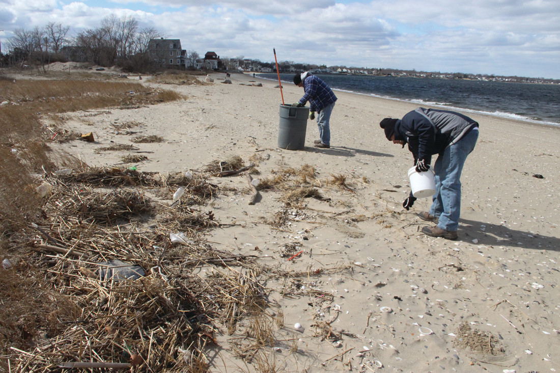 "MEDIA PICKUP: East Providence city workers retrieve ""plastic media"" that was introduced into Upper Narragansett Bay from the city's wastewater treatment plant during the March 3 storm and washed ashore on Conimicut Point."