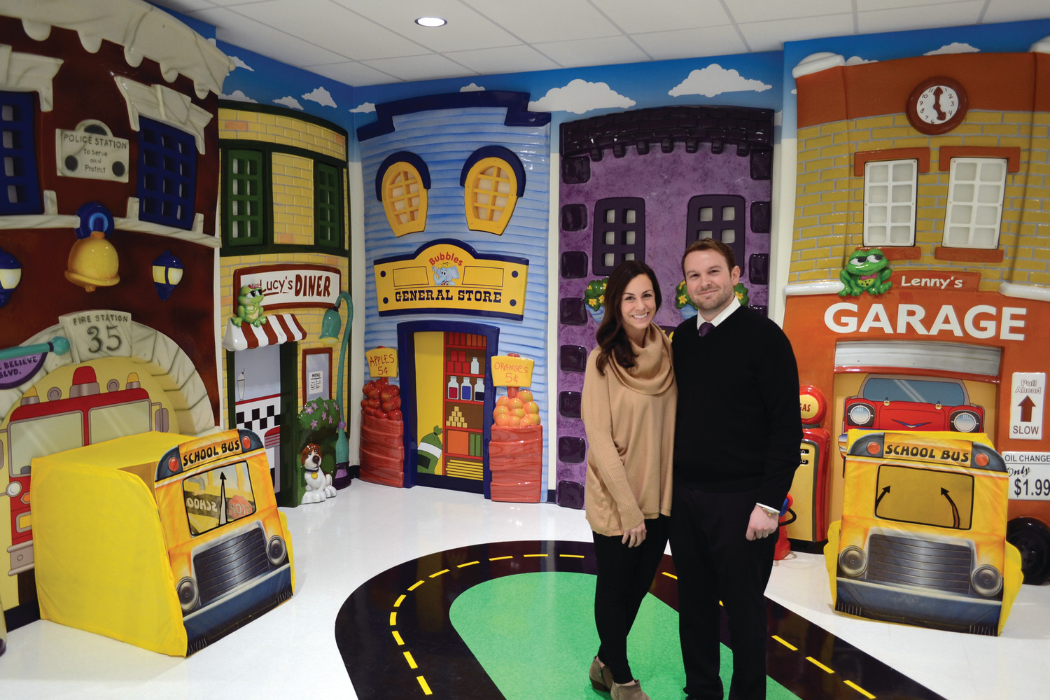 "MAKE BELIEVE MADE REAL: Amanda and Nicholas Hemond are co-owners of the new Learning Experience early learning center on Jefferson Park Road in Warwick, inside ""Make Believe Boulevard,"" a playroom inside the brand new facility."