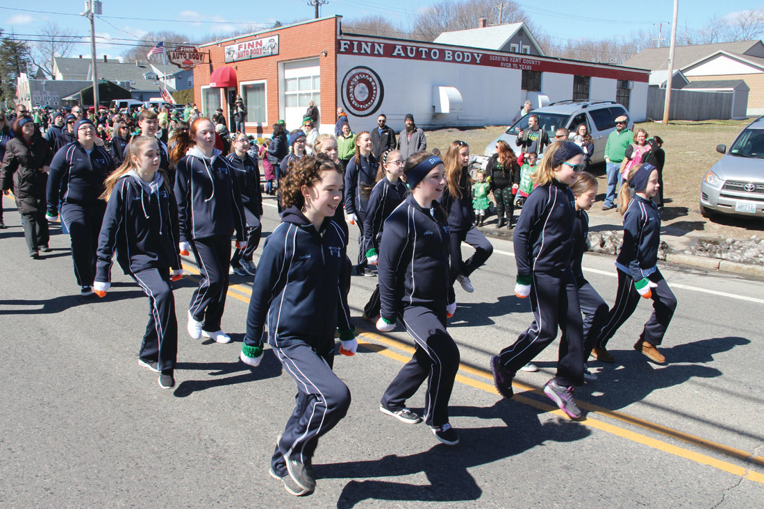 Dancers from the Damhsa Irish Dance Studio of Warwick livened the step of the march.