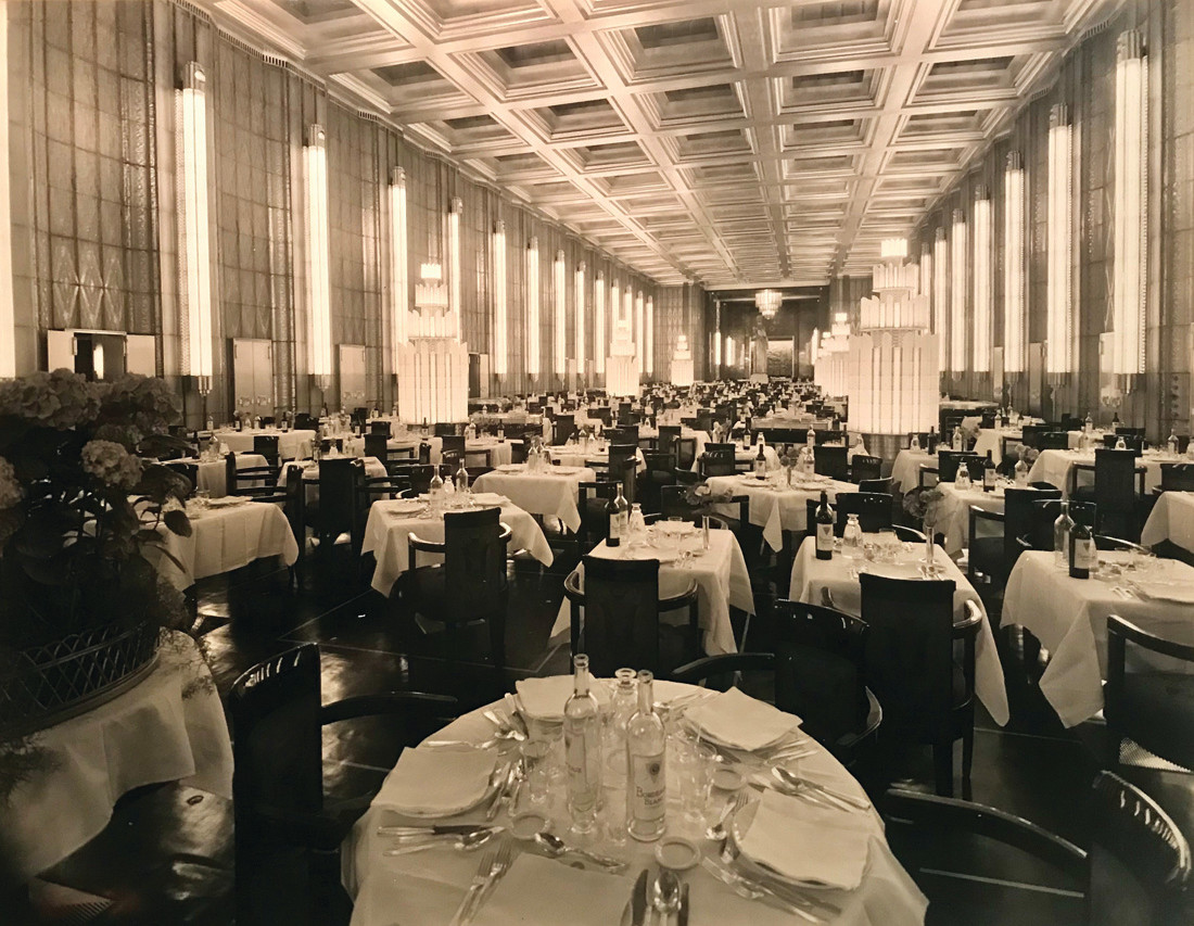 GRAND ROOM AT SEA: The longest room ever to go to sea (305 feet), the first class dining room was covered with backlit glass panels, 16-foot-tall Lalique glass towers, an illuminated coffer ceiling and two gorgeous chandeliers.