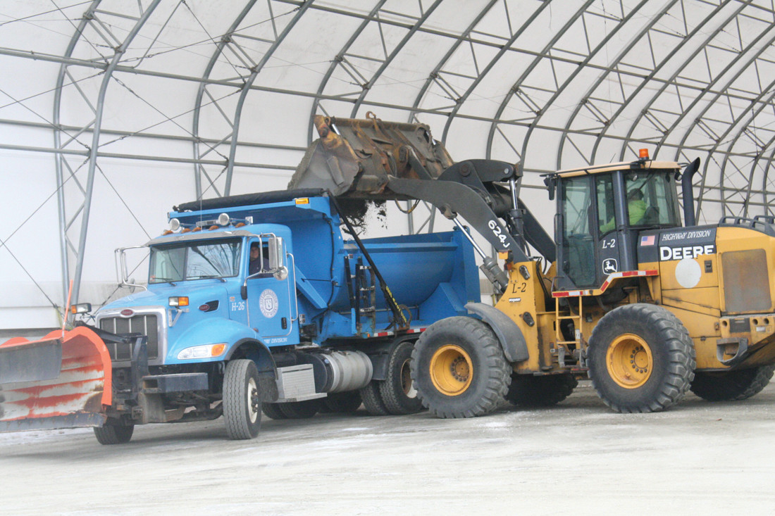 SALT ON THE MOVE: DPW trucks load up with salt at the headquarters on Phenix Avenue to ready themselves to keep the road safe during the impending blizzard.