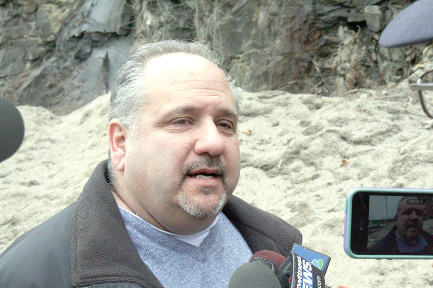 WE'RE READY: John Corso, Highway Superintendent for Cranston's Department of Public Works, talks about the upcoming storm Monday afternoon near the rapidly depleting salt-pile at their headquarters on Phenix Avenue.