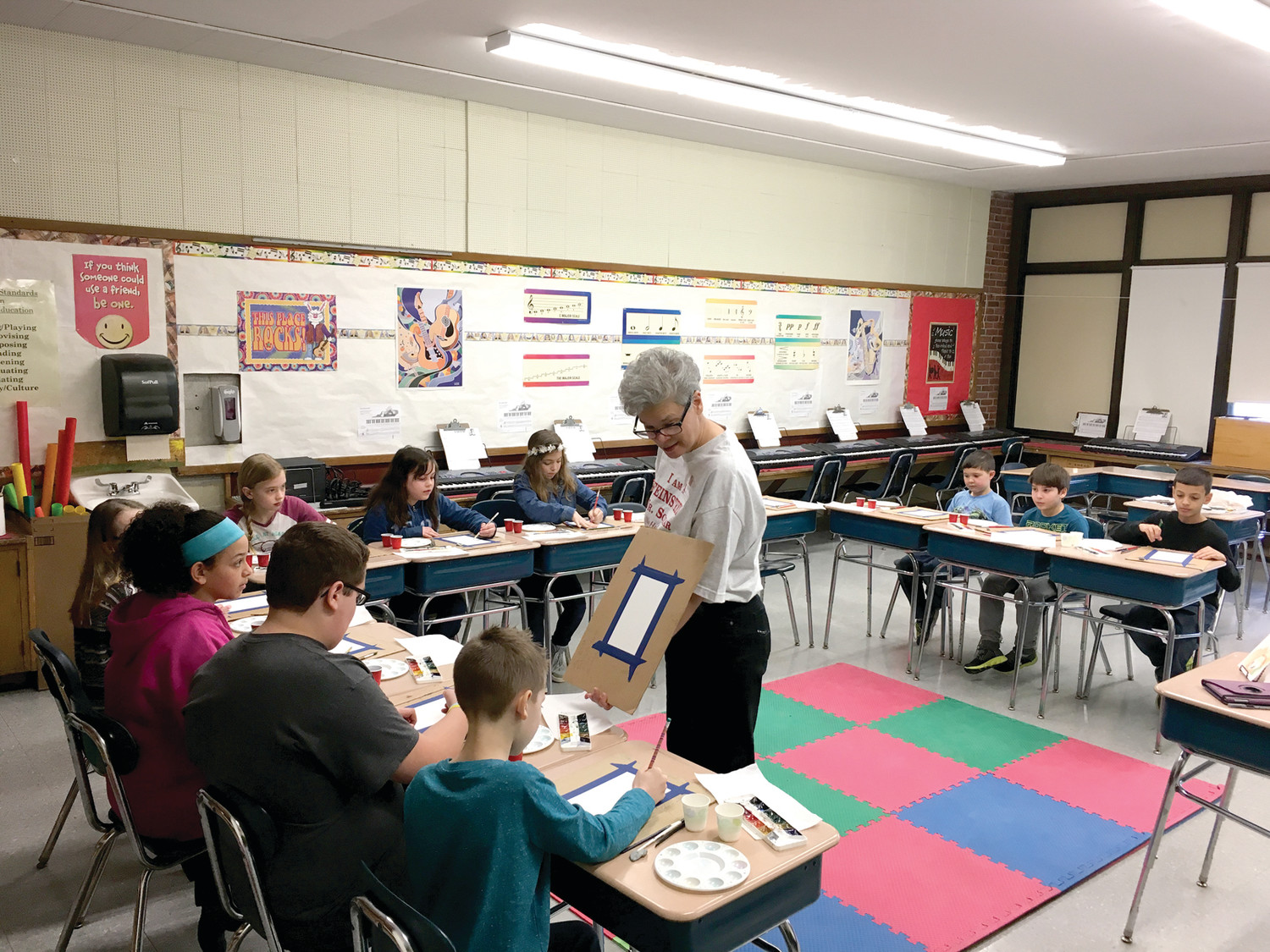 LESSON FROM AN ARTIST: Watercolorist Sue Greco teaches a class at Holliman School.