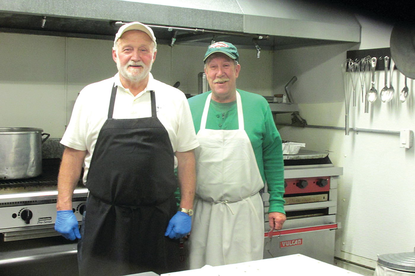 COOK'S CORNER: Bob Hartington (left) and Steve Lagesse prepared and cooked Saturday night's St. Patrick's Corned Beef and Cabbage Dinner that drew rave reviews from all 150 attendees.