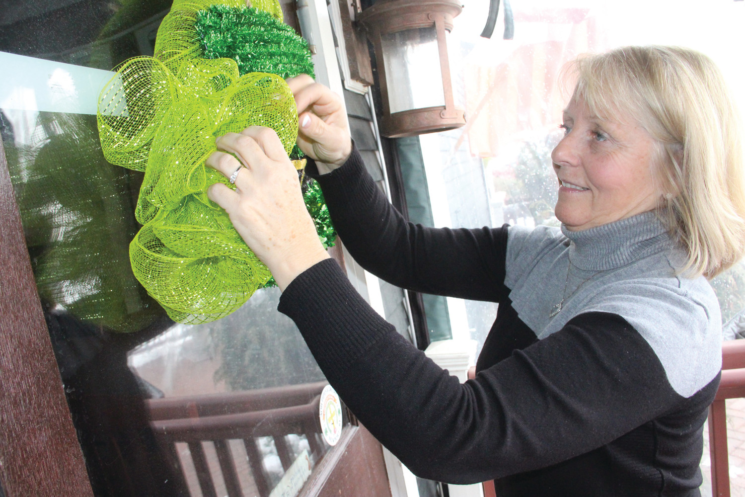 Laurie O'Rourke prepares for the St. Patrick's Day celebration.