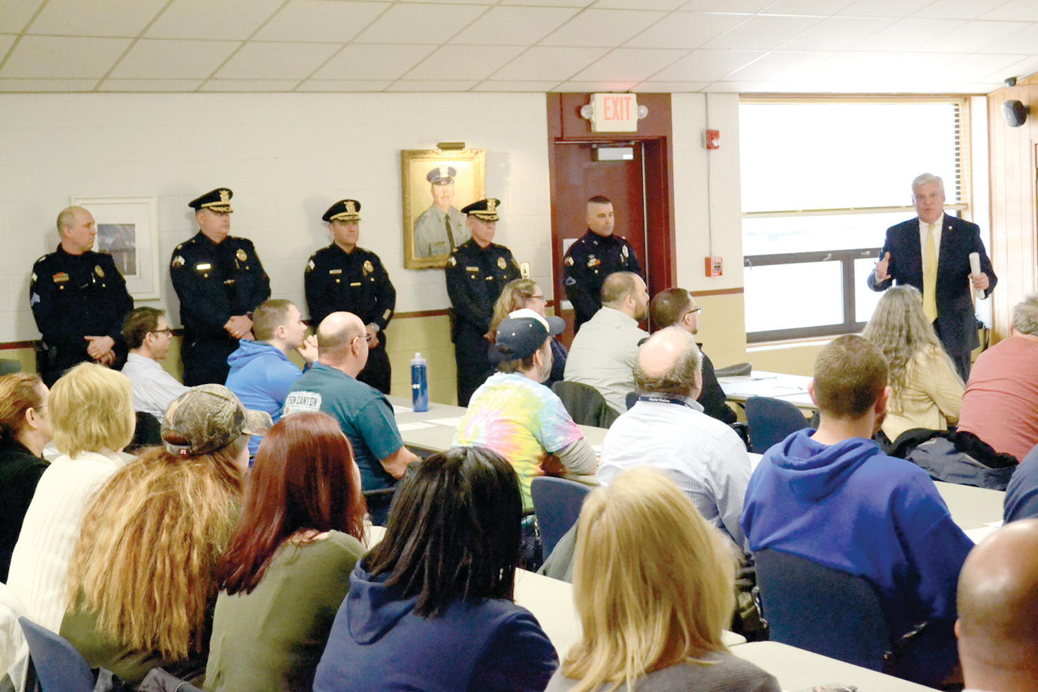 CLASS IN SESSION: Mayor Scott Avedisian provided welcoming comments to the 30th class of the Warwick Police Department's Citizens' Police Academy. Community police officer Daniel (to his left), a 17-year veteran of the Warwick Police Department, instructs the class.