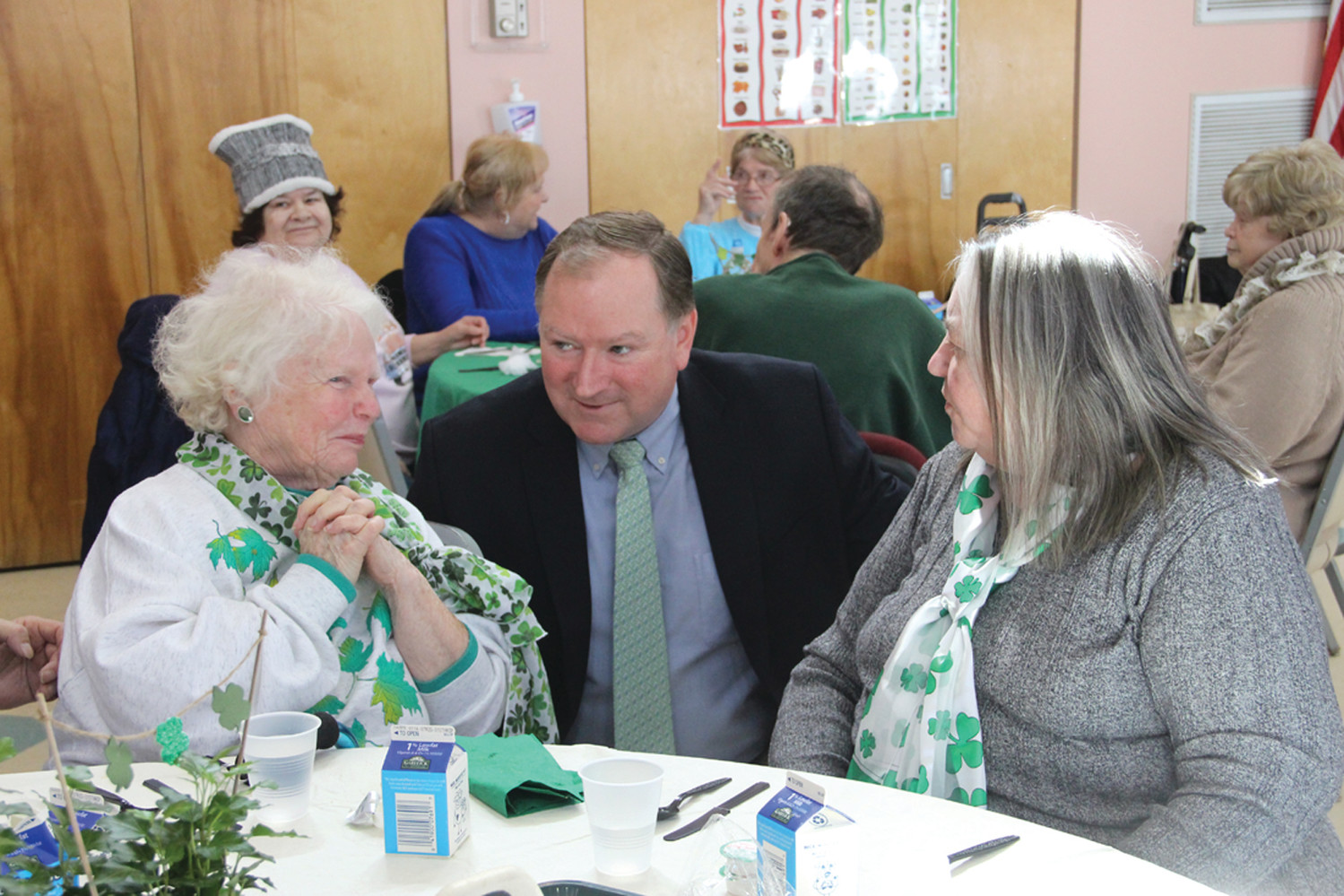 ONE-ON-ONE: Senator Michael McCaffrey, who hosted the luncheon, talks with Pat Pontarelli and Rosemary Daniels.