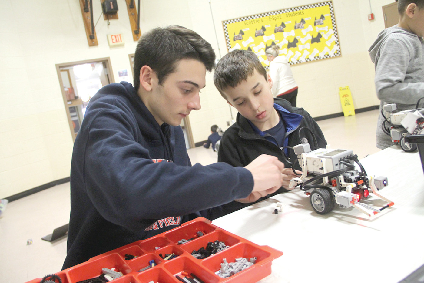 MAKE IT GO FAST: Andrew Mullaney, who thinks he would like to be an architect, was curious how he could program his robot to go faster. He got some assistance from Toll Gate senior Cole Baker. Baker is hopeful of attending UMass and studying engineering.