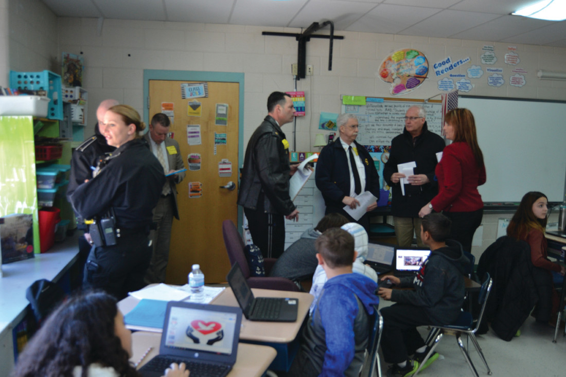 NO STONE UNTURNED: During the tour provided by Principal Zarcaro, the threat assesment team visited every corner of the school in an effort to understand what areas were safe and what areas needed improvement. (Johnston Sun Rise photos by Tim Forsberg)