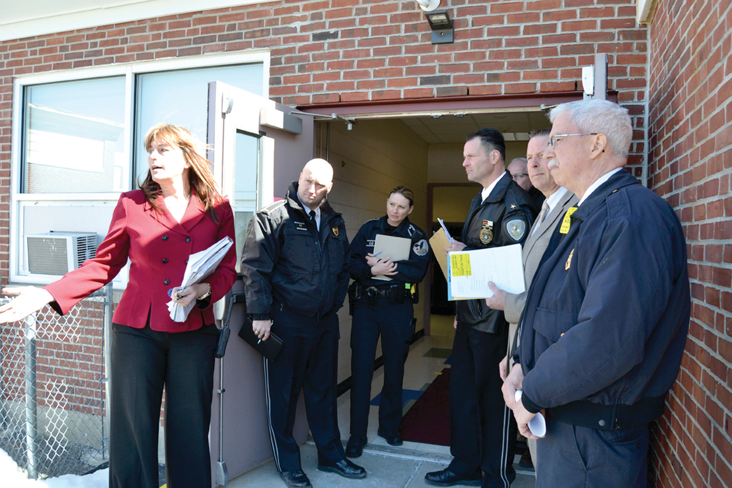 SAFETY FIRST: Winsor Hill Principal Michele Zarcaro (left) provided a threat analysis tour of the school to Police and Fire officials on Monday.
