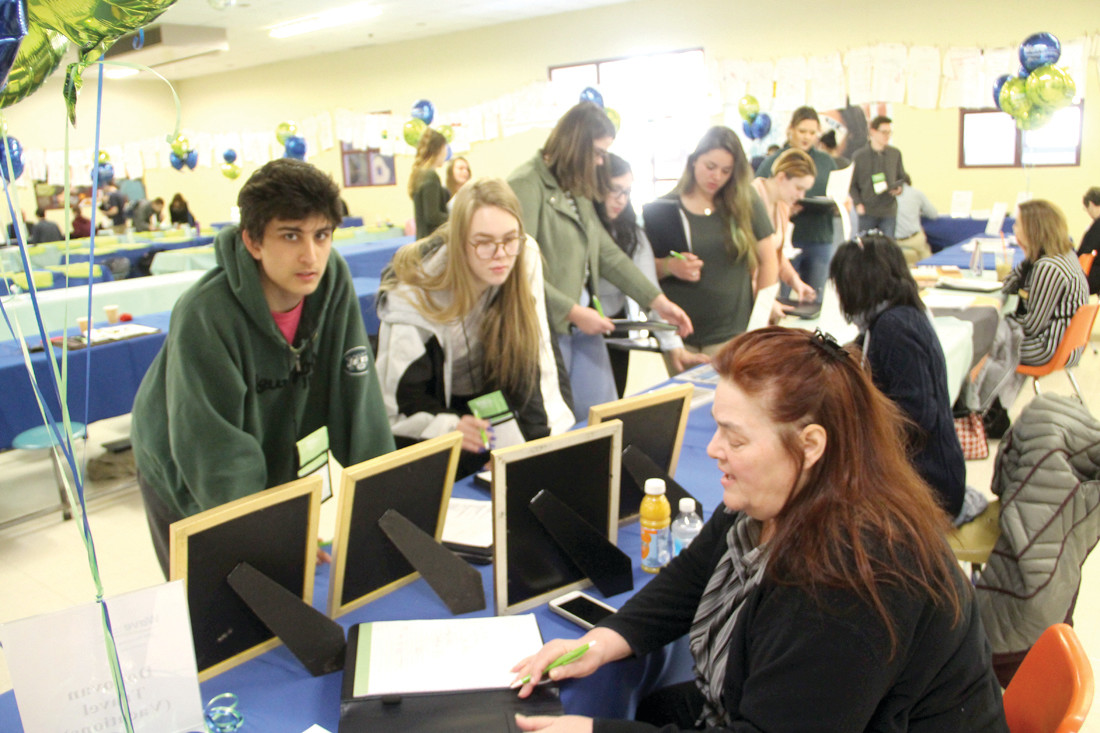 most students watch pennies at school financial fair. Black Bedroom Furniture Sets. Home Design Ideas