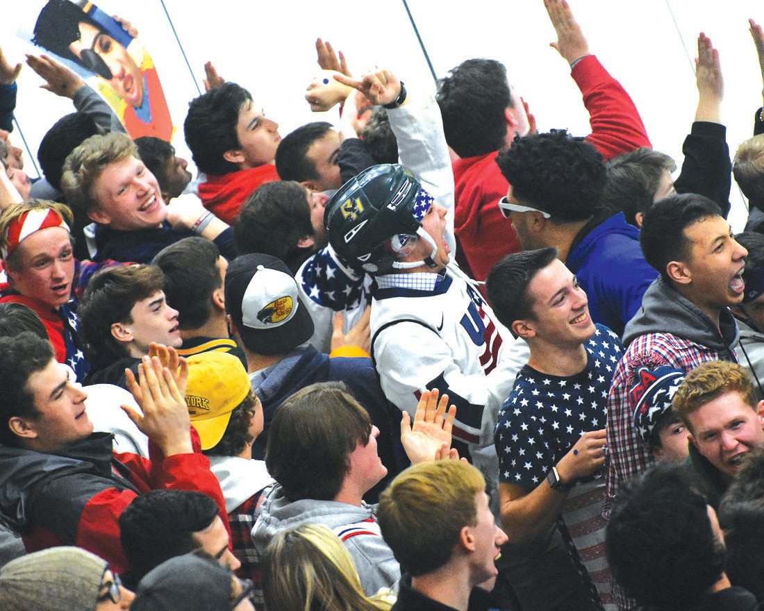 SWARMING THE STANDS: Hendricken's enthusiastic cheering section roots on the Hawks during their 3-1 win over La Salle in Game 1 of the state championship series Friday night.