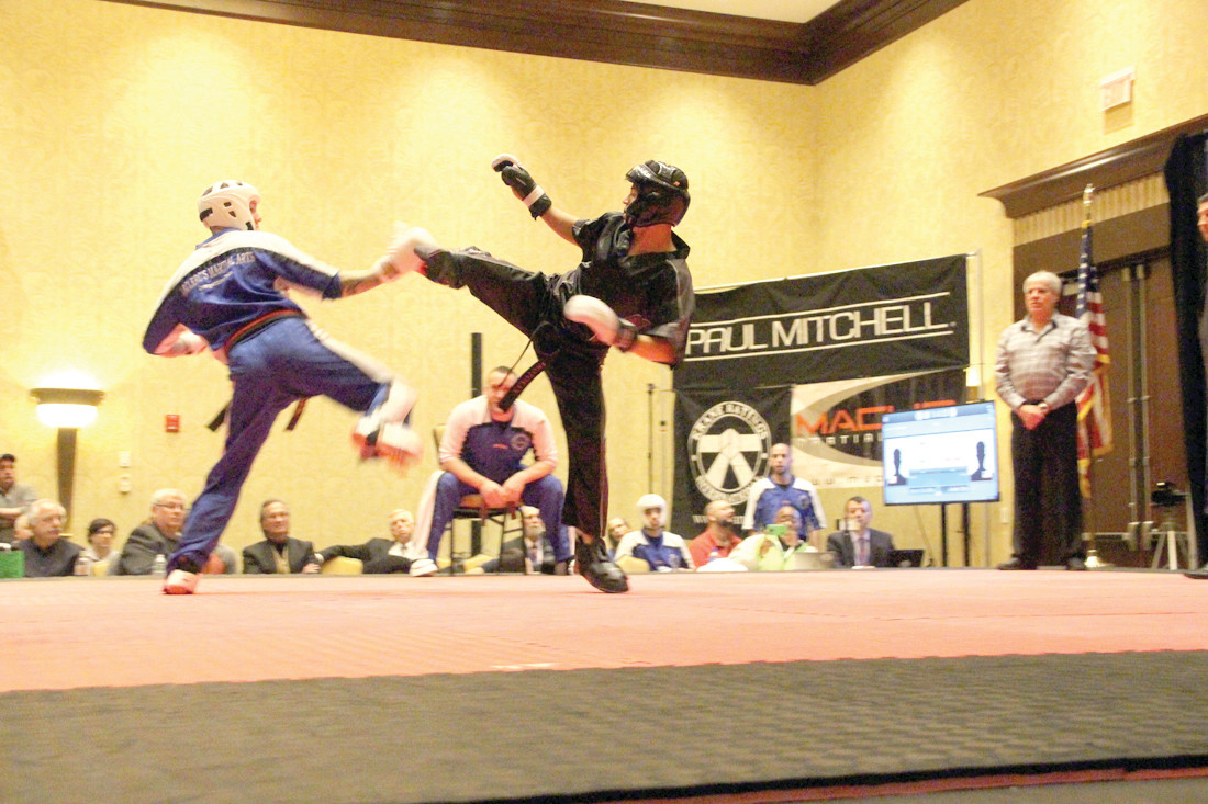 A GRAND DISPLAY OF KARATE: Pictured above is action from last year's tournament, held at the Crowne Plaza in Warwick. The Ocean State Grand Nationals tournament attracts between 3,000 and 4,000 participants and spectators and features over 350 divisions of martial arts, from kids under 5 to adults over 50.