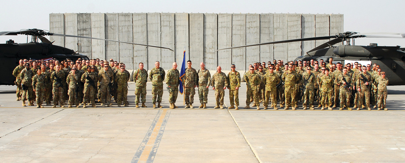 DEPLOYED: From a photo taken at Camp Taji, Iraq on March 20, U.S. Army Rhode Island Maj. Gen. Christopher Callahan and Command Sgt. Maj. Moises Moniz, who is the Rhode Island state commander of the National Guard met with soldiers assigned to the 1st battalion, 126th aviation regiment from Rhode Island. (Submitted U.S. Army photo by Staff Sgt. Leticia Samuels)