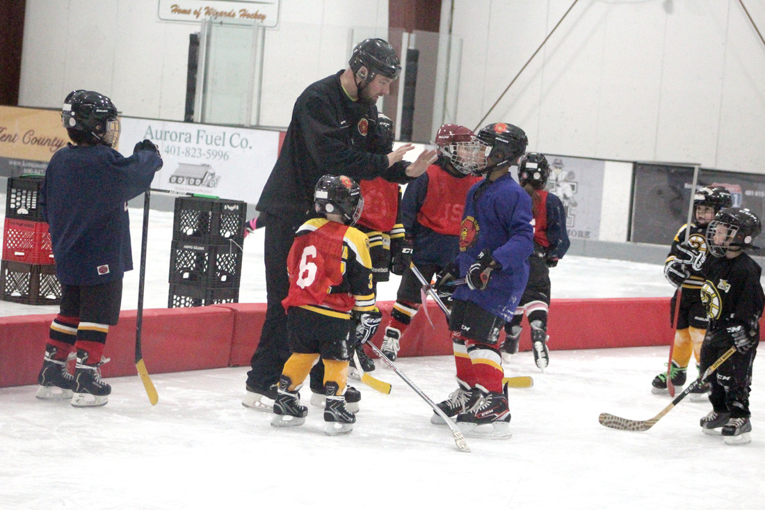 Knights hockey player Billy Whelan instructs kids in ice skating and playing hockey.