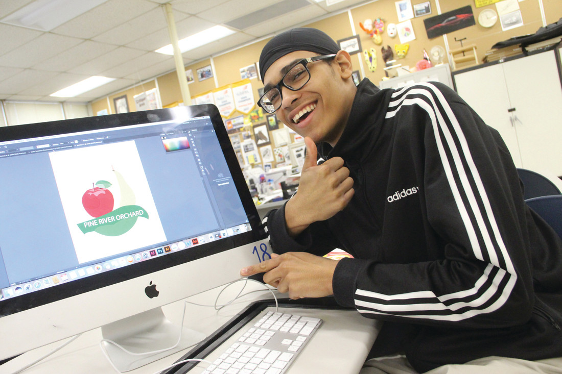 HE HOPES THEY'LL PICK IT: Marc Hernandez designed a logo featuring an apple and a pear as a logo for Pine River Orchards in New Hampshire.