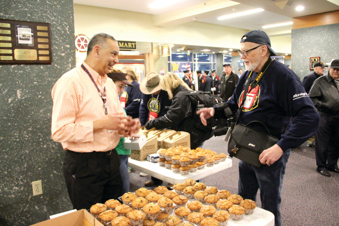THE DONUT MAN: Merabet Mourad, manager of the two Dunkin' Donuts at Green Airport, had an impressive spread for the veterans and their guardians. The spread is a donation of Wayne Moore (at right), a volunteer who has been on almost every flight since they started.