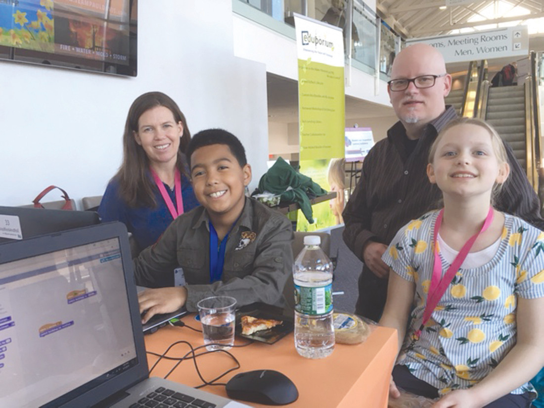 PROUD TEACHER: 5th grader Corey and 4th grader Sara at the Blended Learning Conference with their coding facilitator/coach Jill Robbins, 4th grade Barrows teacher.