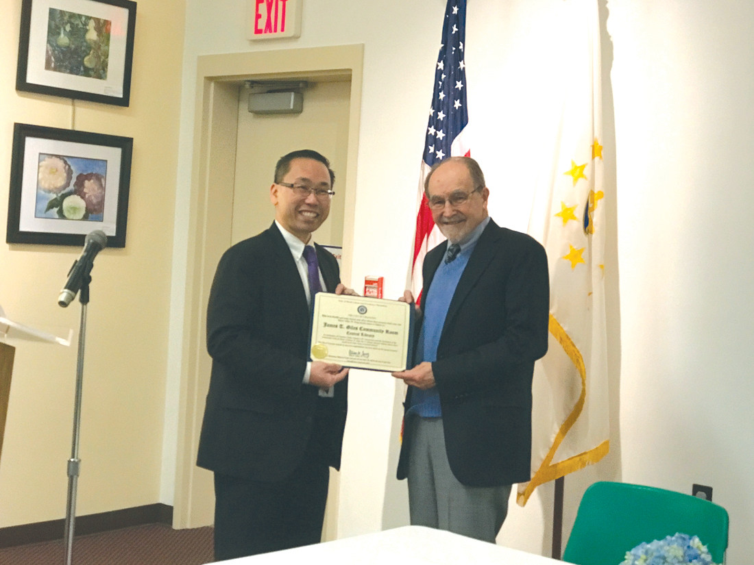 THANKS FOR YOUR SERVICE: Mayor Allan Fung presents former library director Jim Giles with a citation at the 50th anniversary party of the Cranston library.