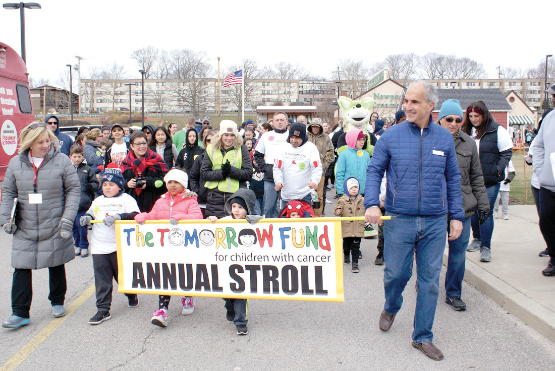THE STEP OFF: The 16th Annual Tomorrow Fund Stroll in Garden City stepped off at 10 a.m. this past Sunday with their banner in the lead.
