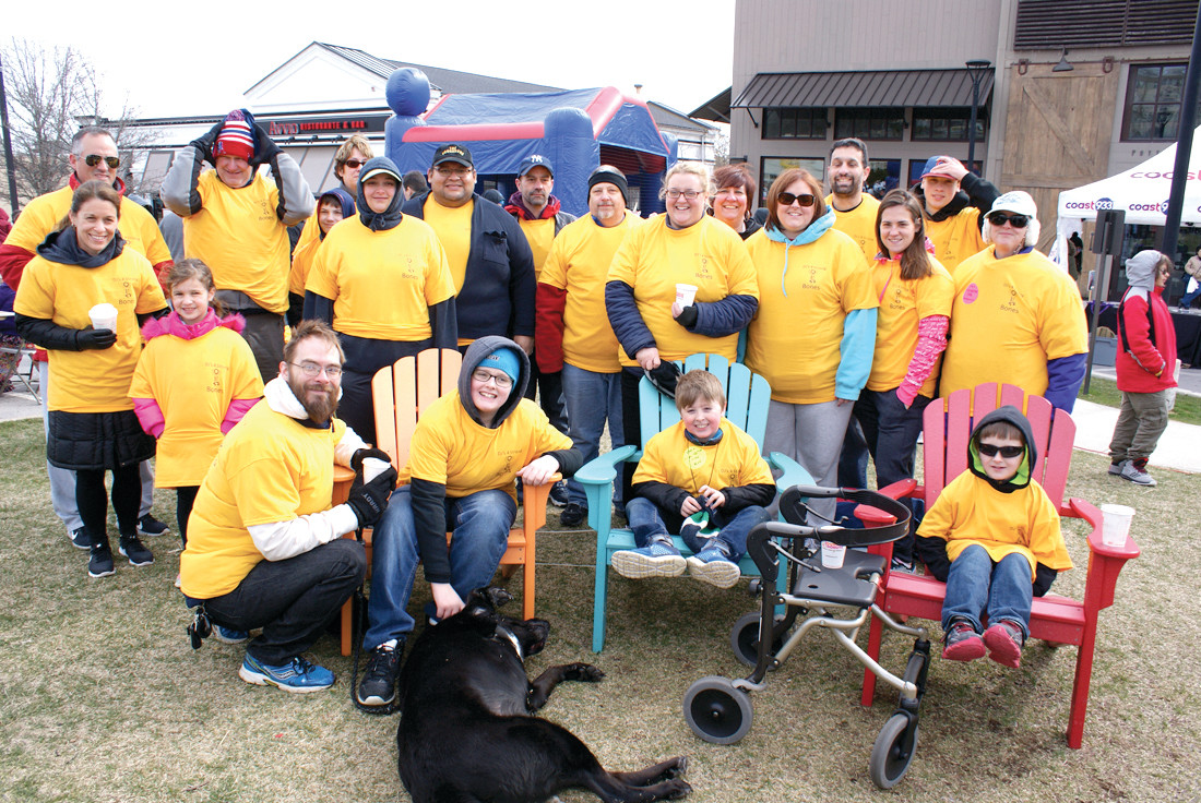 TEAMWORK: One of the largest organized teams during the Tomorrow Fund Stroll in Garden City this past Sunday as Team DJ's for Strong Bones in honor of Diane Johnson, age 8, who is seated in the blue chair.