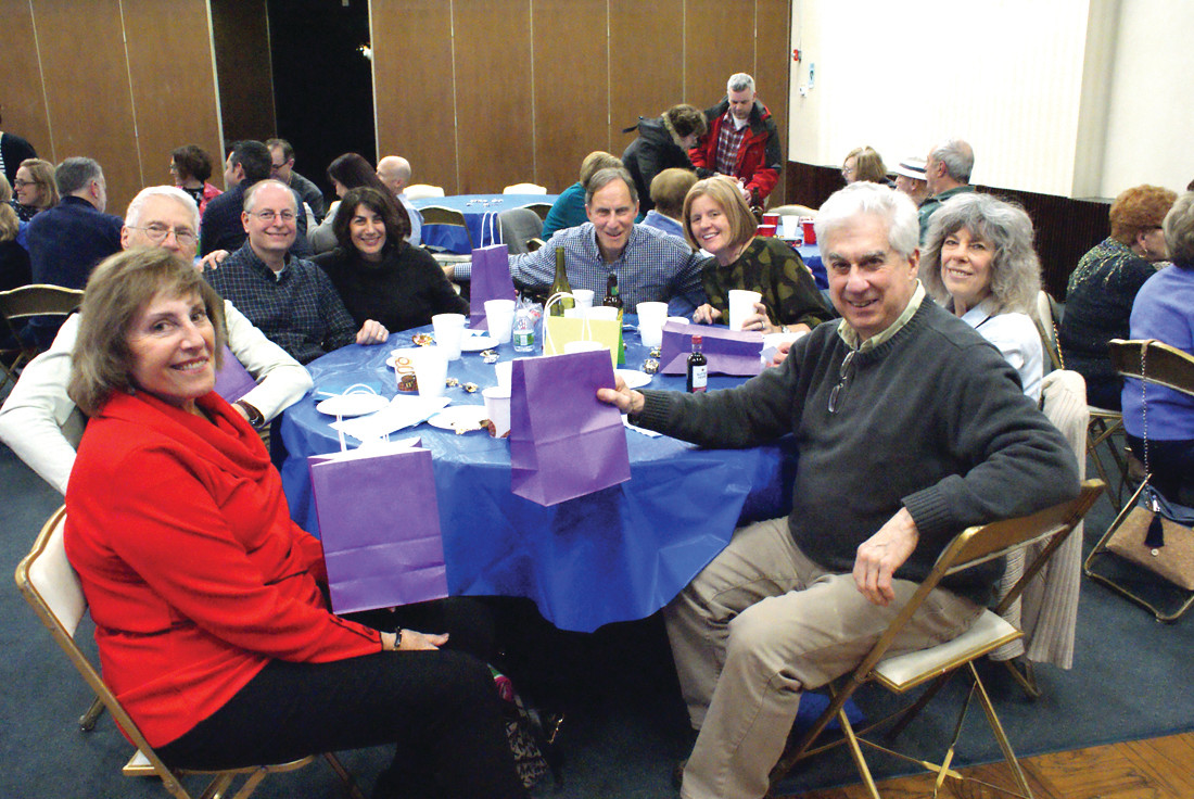 THE WINNERS: The winning team at Temple Sinai's Trivia Night were the Wondering Jews, who took home the top prize for the evening with the most points. At the table are Maureen Krasnow, Stanley Bleecker, David Wollin, Joan Wollin, Scott Fertik, Lisa Fertik, Debbie Katz and Herb Katz.