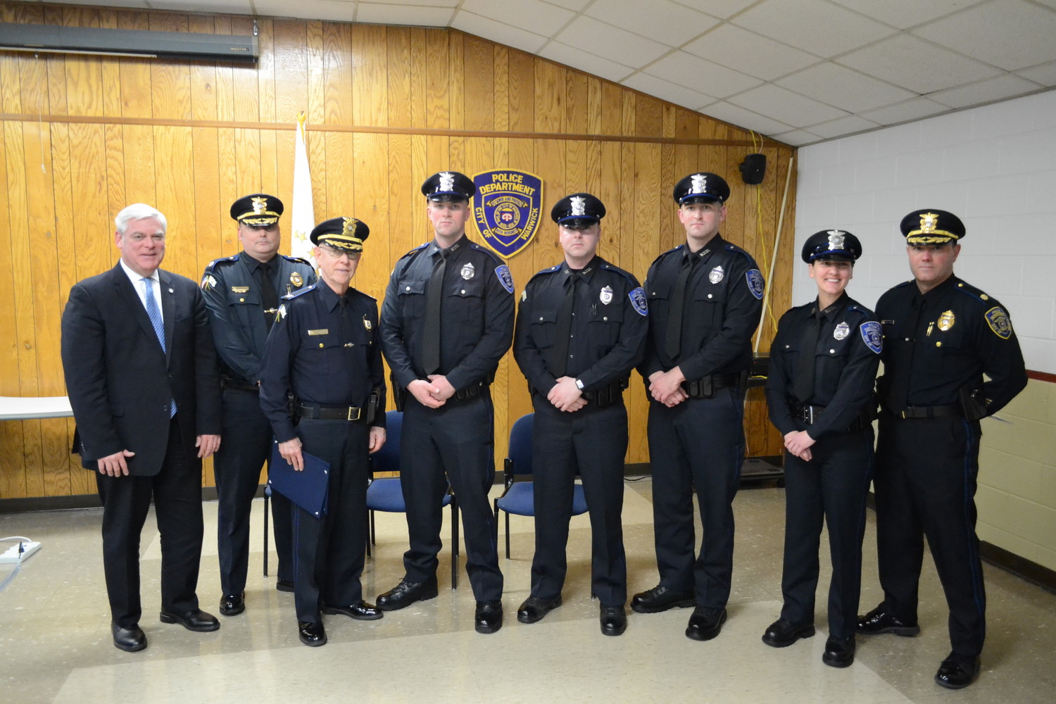 NEW COPS ON THE BLOCK: Mayor Scott Avedisian joins Major Rick Rathbun, Colonel Stephen McCartney, officers Randy Bell, Justin Martin, Jonathan Burn and Karen Haarr, and Major Brad Connor.
