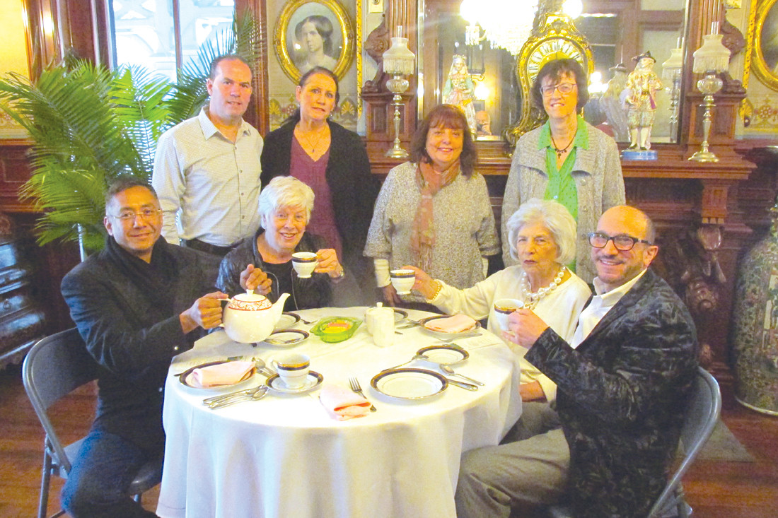 TIM'S TURN: Timothy Kee (seated left) is about to pour tea for fellow JHS members during last Friday's High Tea in Warwick. His table includes: Rosanna Gaulin, Phil and Laurie Lemoi, Sharon Rogers, Linda Emery, Carol Parish and Anthony Ursillo.