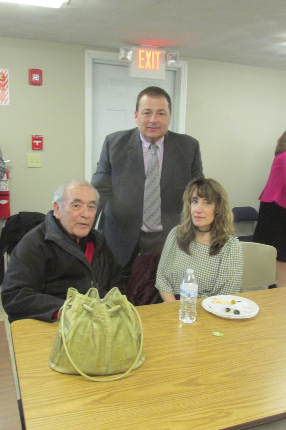 GRASSO'S GREETING: Johnston Municipal Court Associate Judge Jackie Grasso is joined by her father Joe Grasso and H. Joseph Shekarchi, House Majority Leader and a State Rep. from Warwick, at Tuesday's Networking Luncheon.