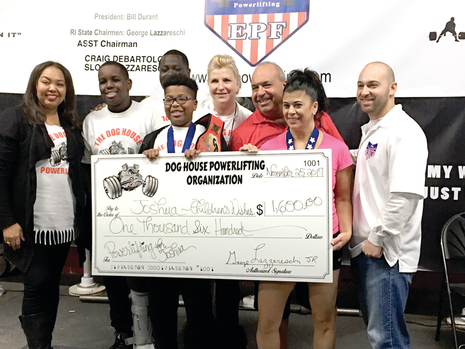 SUPER SCENE: Officials from The Dog House Powerlifting Organization and Children's Wishes were all smiles back in November, 2017 after an event raised $1,600 for Joshua Jean Louis, an 11-year-old who has a serious heart condition.