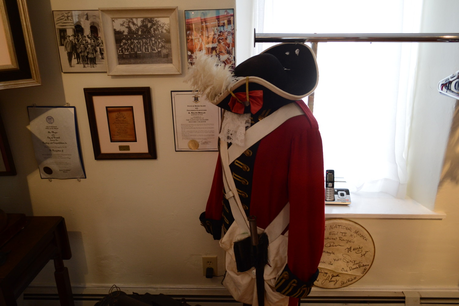ALL DRESSED UP: A modern Pawtuxet Ranger uniform on display at the company's new museum exhibit at the Pawtuxet Armory Hall.