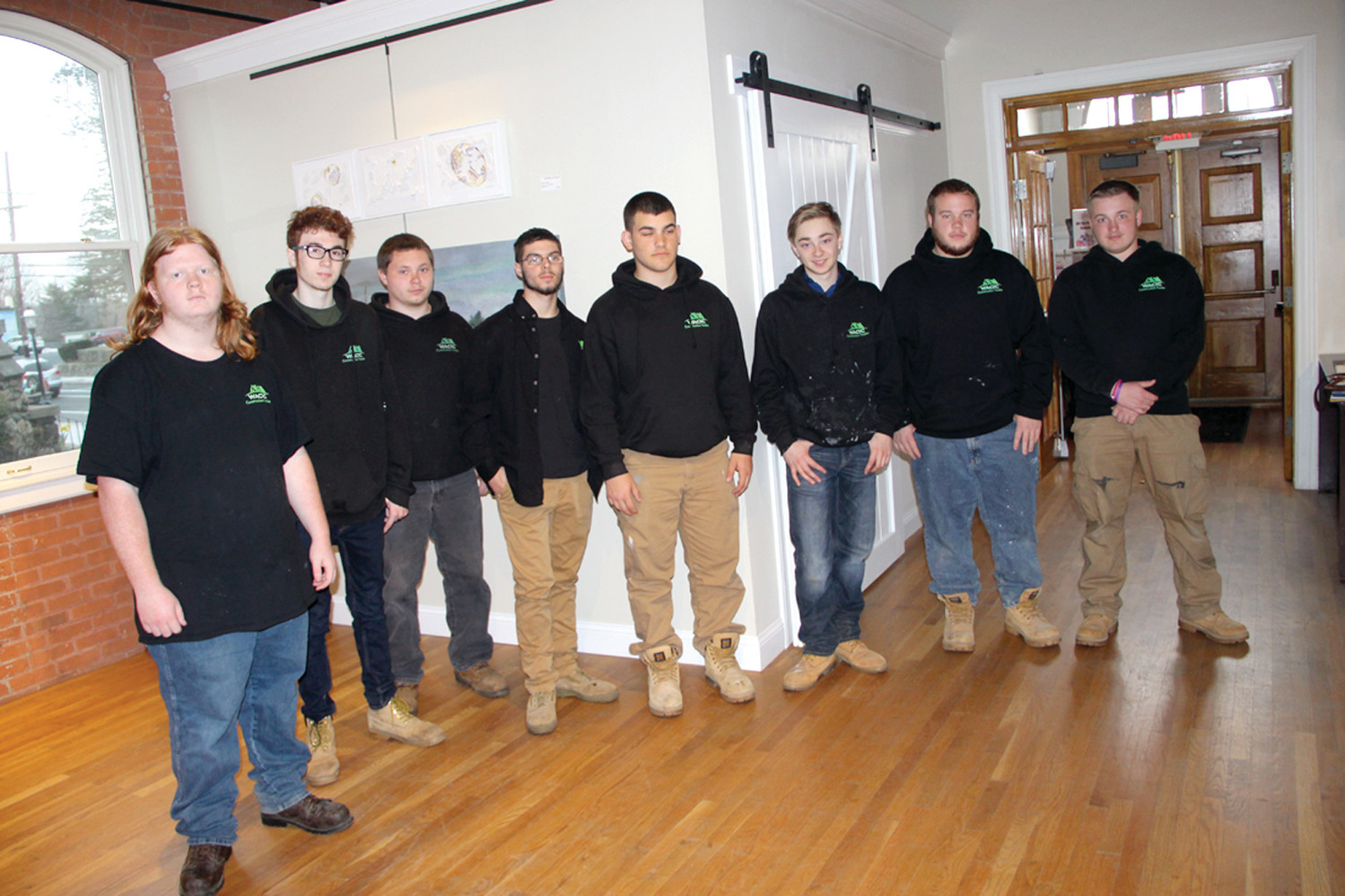 ON EXHIBIT: Warwick Area Career and Technical Center construction trades students created a storage area at the Warwick Center for the Arts by moving a wall and creating a room. Standing in from of their work, which blended in with the gallery, even providing more display space are from left: Drew Hottes, Tyler Moran, Brandon Dutra, Zachary Corey, William Martino, Emidio DeSousa-Rosa, Ryan Pietros and Tyler Scotti.