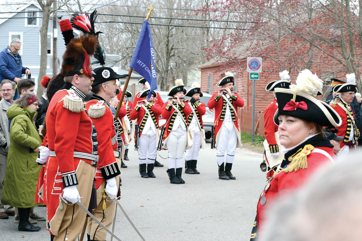 MARCHING ORDERS: Lee Singer, front with fife, leads the Pawtuxet Rangers in the playing of a brand new marching son, written by Singer and performed for the first time on Sunday.