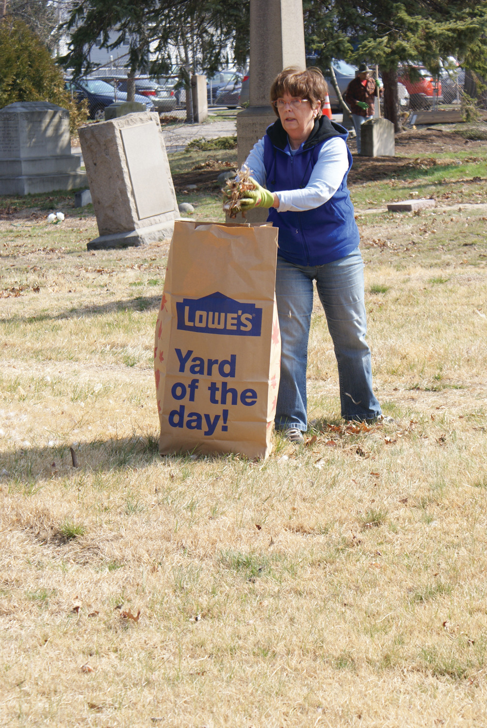 DOING HER PART: Linda Martin, a volunteer from Carpenter Jencks Funeral Home in Warwick, volunteered her day for the cleanup of the historic Oakland Cemetery