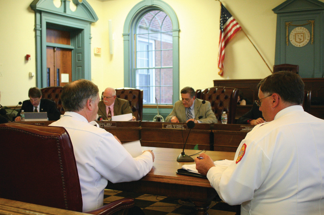 FROM FIRE TO FINANCE: Fire Chief William McKenna presented his budget to the City Council on Monday night, as Finance Committee chairman Michael Favicchio and Councilman Paul McAuley study their notes.