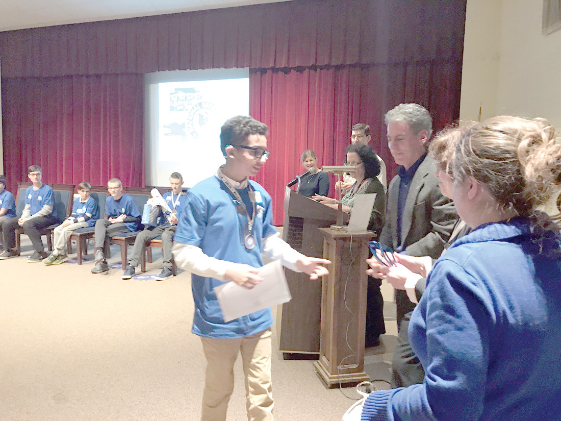 CRANSTON PRIDE: Park View 7th grader David Gomez receives his medal and awards for being a finalist at the Geography Bee.