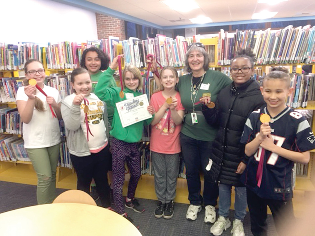 CROWING LIKE A ROOSTER: Savoring the very first victory in the Rooster Games is the team from Chester Barrows. Crystal and Leslie Fernandez; Alexia Reardon; Kara Bush (holding certificate); Grace Michaelson; Barrows librarian Sue Rose; Ariah Cumberbatch (from Eden Park); Gabe Leon.